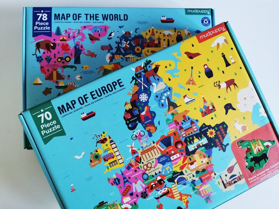 Puzzle Mapa Świata z elementami w kształcie budynków i zwierzą